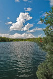 Lake amidst beautiful clouds. Stock Photography