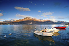 Lake Annecy. Beautiful view of the Annecy Lake in French Alps, a spring day with snow in the mountains and with  boats in the foreground. Annecy. Haute Savoie Royalty Free Stock Images
