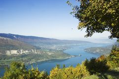 Lake of Annecy. Panorama of Annecy's lake, view from Forclaz, with a paragliding far away Royalty Free Stock Photo