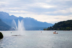 Lake Annecy, boating, sailing and paraglider Stock Image
