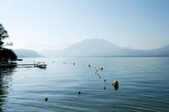 Lake Annecy with diving board and buyos Royalty Free Stock Images