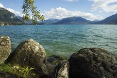Lake Annecy and mountains. View of Lake Annecy with winds and mountains, in French alps, France Royalty Free Stock Image