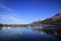 Lake Annecy in winter. Boats in the dock Stock Image