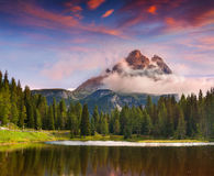 Lake Antorno and Tre Cime of Lavaredo south face in Italy Alps, Royalty Free Stock Images