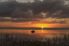 Lake Apopka Florida Summer Sunset with small boat royalty free stock photography