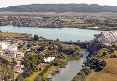 Lake of Arcos de la Frontera. Lake and river of Arcos de la Frontera   with some trees and houses located in the Spanish province of Cadiz, on a clear day. It´s Stock Photos