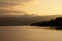 Lake Arenal at sunset, Costa Rica. Volcano can be seen on background. Tropics royalty free stock photography