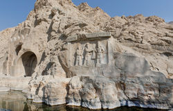 Lake around the ancient relief in Kermanshah - Taq-e Bostan in Iran. Lake around the ancient relief in Kermanshah - Crowning ceremony of Ardashir II. Stone Stock Photo