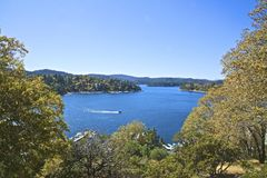 Lake Arrowhead California. Scenic aerial view of blue waters of Lake Arrowhead and green trees in the mountains of California Stock Photos