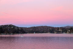Lake Arrowhead in pink. Peaceful lake Arrowhead turing pink after sunset during twilight Royalty Free Stock Photos