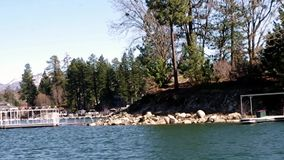 Lake Arrowhead Queen boat Tour Celebrity estates. Arrowhead Lake Mountain Boat tour of celebrity homes and historical landmarks on Lake Arrowhead San Bernardino stock video footage