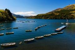 Lake Ashi, Hakone. Fishing boats and Red Torii gate on lake Ashi, Hakone, Japan Stock Images