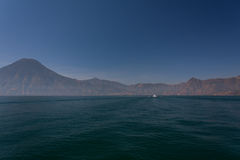 Lake Atitlan boat and volcanoes. Guatemala Stock Images