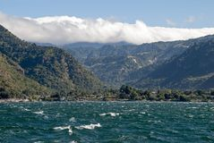 Lake Atitlan with Sierra Madre mountains Royalty Free Stock Photography