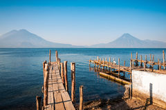 Lake Atitlan and Volcano views from the old pier in Panajachel,. Old rickety wooden piers out into Lake Atitlan in Guatemala on the shore in Panajachel with Stock Image