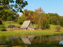 Lake and autumn. Lake, old house and pond in colours of autumn stock image