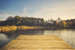 Lake in autumn, colorful robes, yellowed, colorful leaves on tre Stock Photos