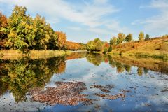 Lake in autumn colours. stock images