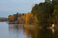 Lake in autumn forest stock photography