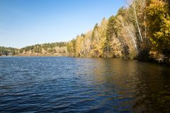 Lake in autumn forest. Small Lake in autumn forest Royalty Free Stock Image