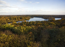 Lake in autumnal forest Royalty Free Stock Images