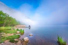 Lake awakening morning fog Royalty Free Stock Photo