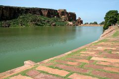 Lake at Badami. Lake Agusthya Teertha at Badami (with southern hill in background and dressed stone bund in foreground), Karnataka, India, Asia Royalty Free Stock Photography