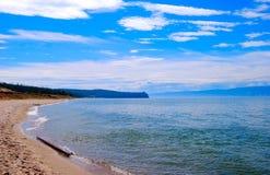 Lake Baikal. Calm Lake Baikal, mountains on the horizon Stock Image