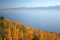 Lake Baikal in autumn. Lake Baikal in the fall with mountains in the background Stock Photos