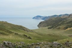 Lake Baikal, beautiful blue water and green hills Royalty Free Stock Photography
