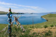 Lake Baikal, beautiful blue water and sky and totems Royalty Free Stock Photos