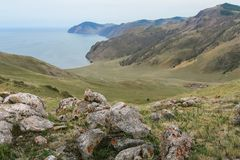 Lake Baikal, beautiful blue water and sky and stones Royalty Free Stock Images