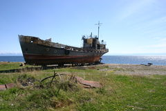 Lake Baikal, Irkutsk Oblast, Siberia, Russia. Raised boat on the banks of the southwestern tip of Lake Baikal, located in Siberia, between Irkutsk Oblast to the Stock Images