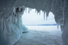 Icicles In A Frozen Grotto. The Lake Baikal is located in southern Siberia of Russia. In the winter the lake and surrounding area becomes ice. The water that royalty free stock images