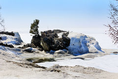Lake Baikal melts in the spring after a harsh winter. On lake Baikal will melt the snow and ice in the spring after a harsh winter, late spring month of may Royalty Free Stock Photos