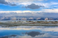 Lake Baikal and mountains with clouds above them stock photos