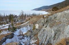 Lake Baikal, the Primorsky ridge, Cape Large Kadilniy in winter morning. Lake Baikal, Primorsky ridge, Cape Large Kadilniy in winter morning stock photos