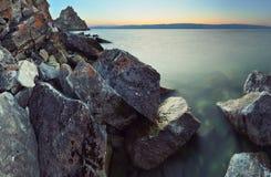 Lake Baikal, Shamanka. Dusk at rocky coast on Olkhon island, lake Baikal Stock Photography
