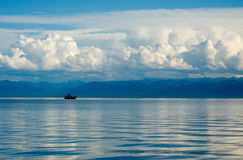 Lake Baikal,the ship against mountains and clouds Stock Photo