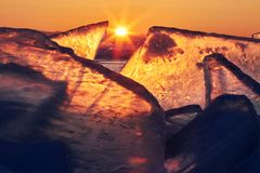 Lake Baikal at sunset, everything is covered with ice and snow, royalty free stock photos