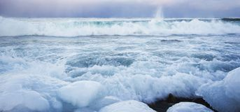 Lake Baikal in winter. Scenic view of Lake Baikal in winter with ice in foreground, Siberia, Russian Federation royalty free stock photography