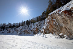 Lake Baikal. Winter. Coast with rocks and pine trees Stock Image