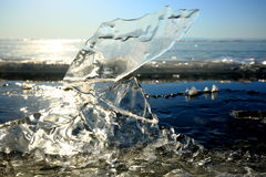On lake Baikal in winter. Ice block on the ice field of the lake in the sun at the Zenith Stock Image