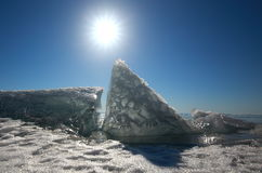 Lake Baikal in winter. Ice block on the ice field of the lake in the sun at the Zenith Royalty Free Stock Photography