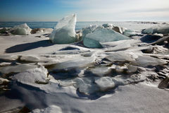 Lake Baikal in winter. Ice block on the ice field of the lake in the sun at the Zenith Stock Image