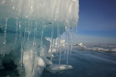 Lake Baikal in winter. Ice block on the ice field of the lake in the sun at the Zenith Royalty Free Stock Images