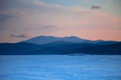 Lake Baikal. Winter. Sunset in blue tones Royalty Free Stock Image