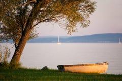Lake Balaton with a boat at sunset Royalty Free Stock Photos