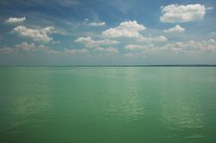 Balaton Lake seen from Balatonfured shore. Lake Balaton  is a freshwater lake in Transdanubian region of Hungary. It is the largest lake in Central Europe, and Royalty Free Stock Photo