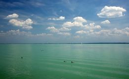 Balaton Lake seen from Balatonfured shore. Lake Balaton  is a freshwater lake in Transdanubian region of Hungary. It is the largest lake in Central Europe, and Stock Photos
